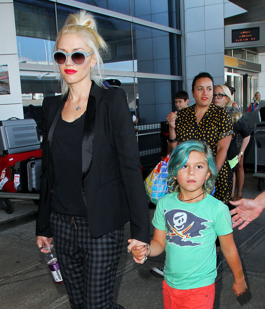 Gwen Stefani held hands with her blue-haired son Kingston at JFK Airport on July 24.