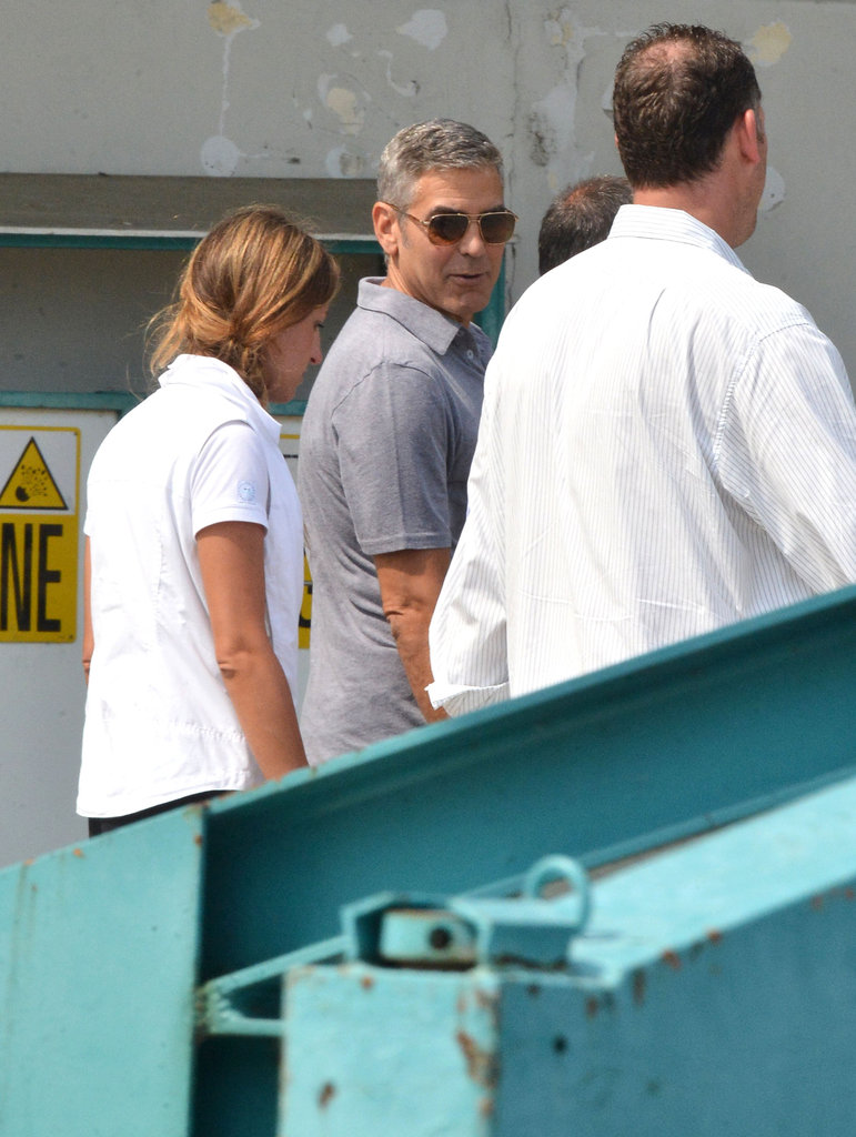George Clooney gave an over-the-shoulder pose.