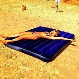 She lounged on an inflatable raft during a beach trip in July 2012. Source: Instagram user barrefaeli