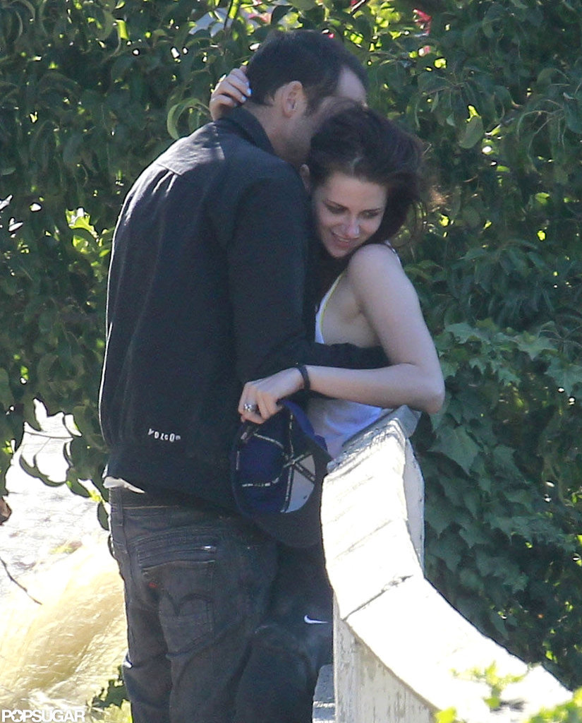 Kristen Stewart smiled while Rupert Sanders hugged her.