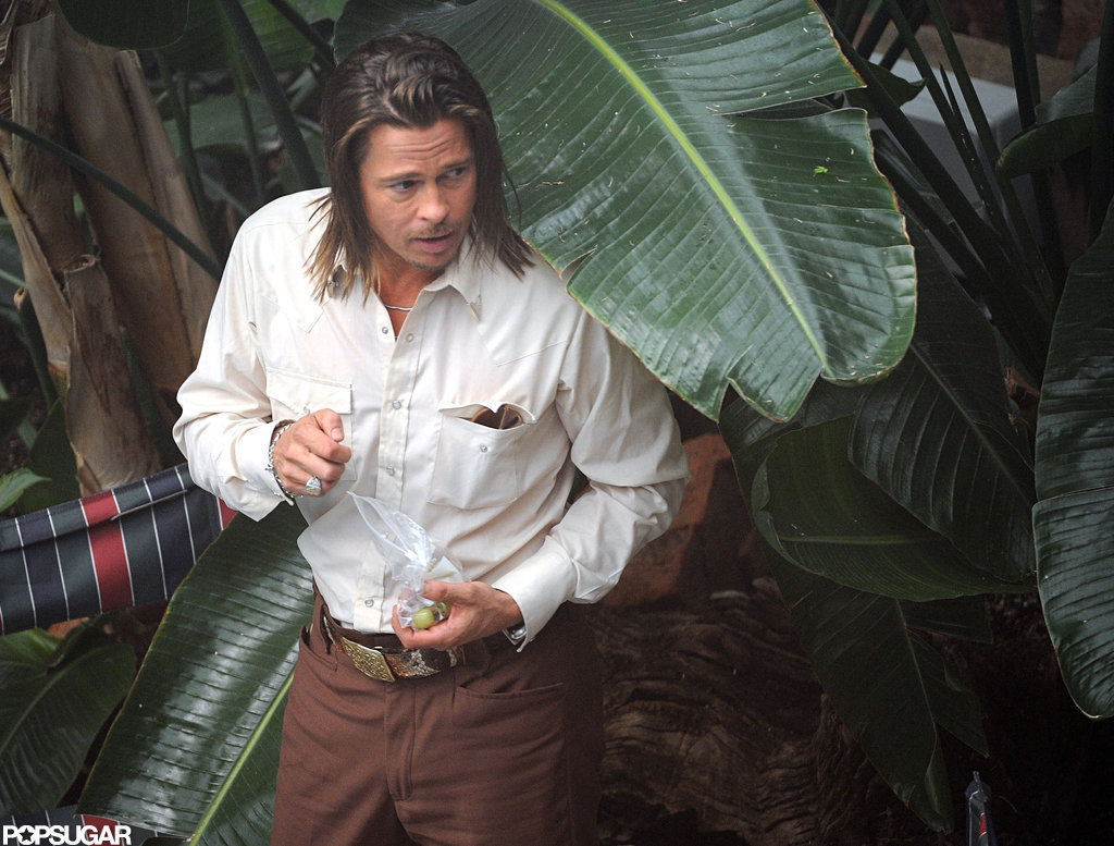 Brad Pitt wore his hair long on set.