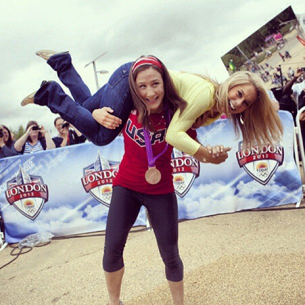 Judo bronze medalist Marti Malloy showed her strength by picking up Shawn Johnson. Source: Instagram user shawnjohn08