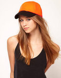 Even in an LBD, you can still play it cool and sporty by throwing on a neoprene baseball cap. ASOS Neoprene Color Block Cap ($13, originally $25)