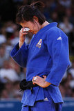 Da-Woon Joung of Korea shed tears after losing her judo fight with Gevrise Emane of France.