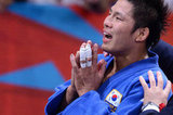 South Korea's Jae-Bum Kim celebrated after winning his judo contest final match.
