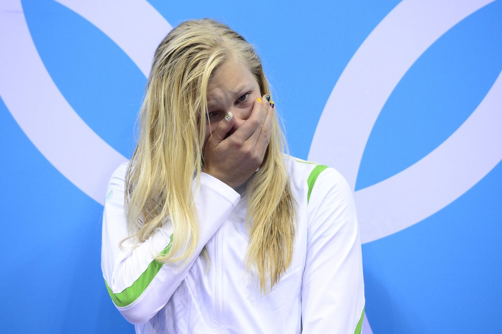 Lithuania's Ruta Meilutyte couldn't believe she won a gold medal in the 100-meter breaststroke.