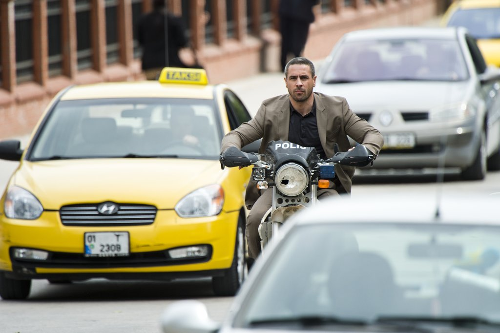 Ola Rapace rides on what appears to be a damaged police motorcycle in Skyfall.