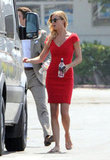 Emily VanCamp headed for a van on set.