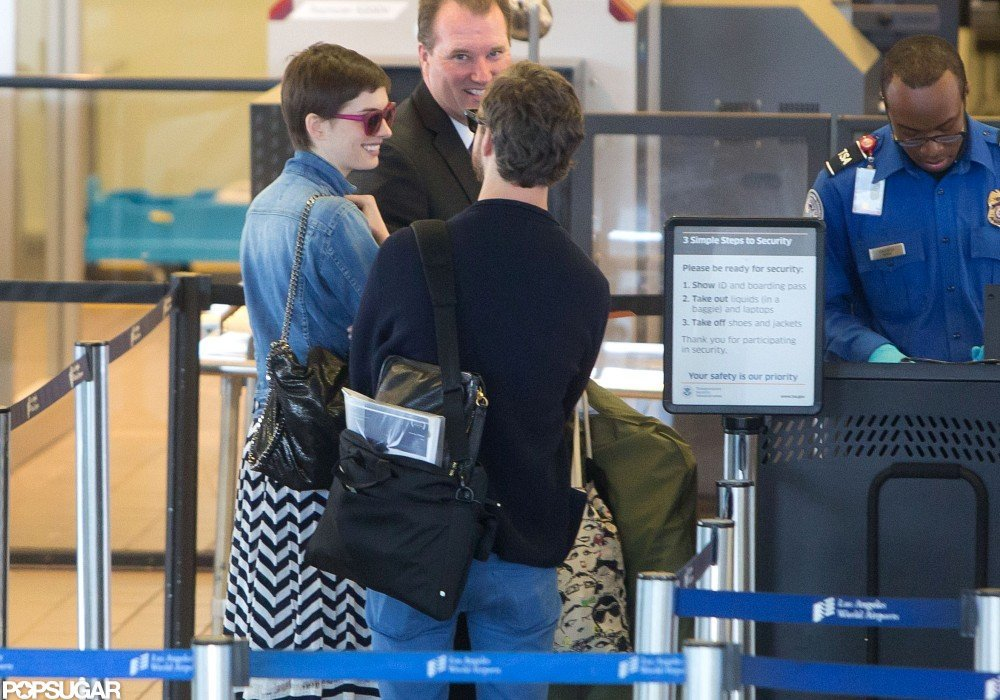 Anne Hathaway arrived at LAX with her fiancé Adam Shulman.