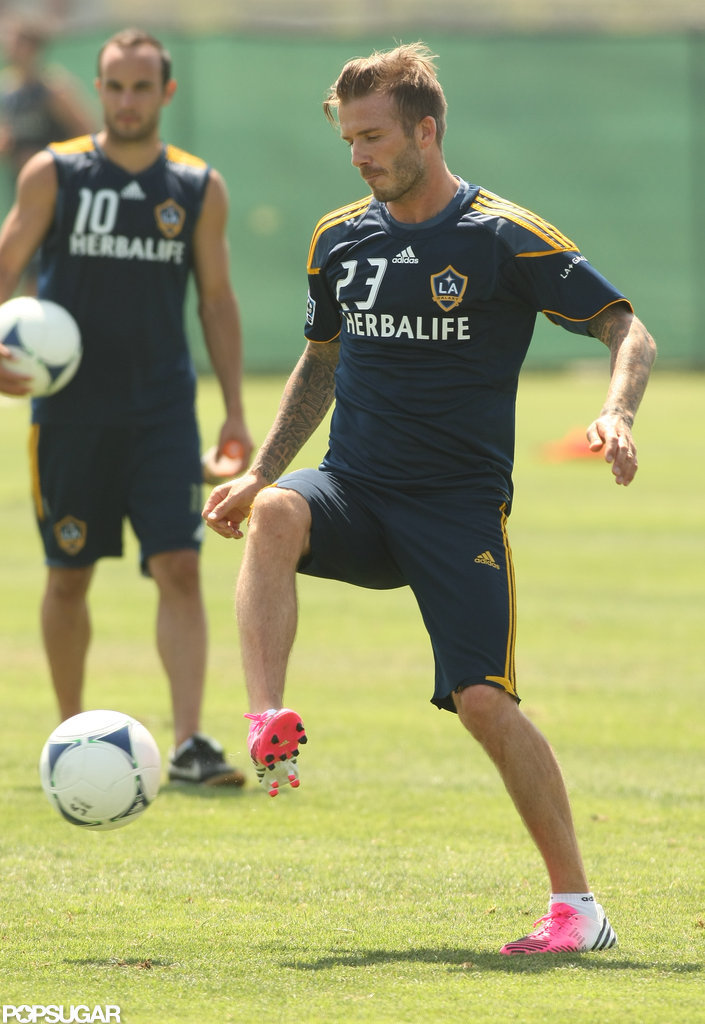 David Beckham kicked the ball to teammates during practice in LA.