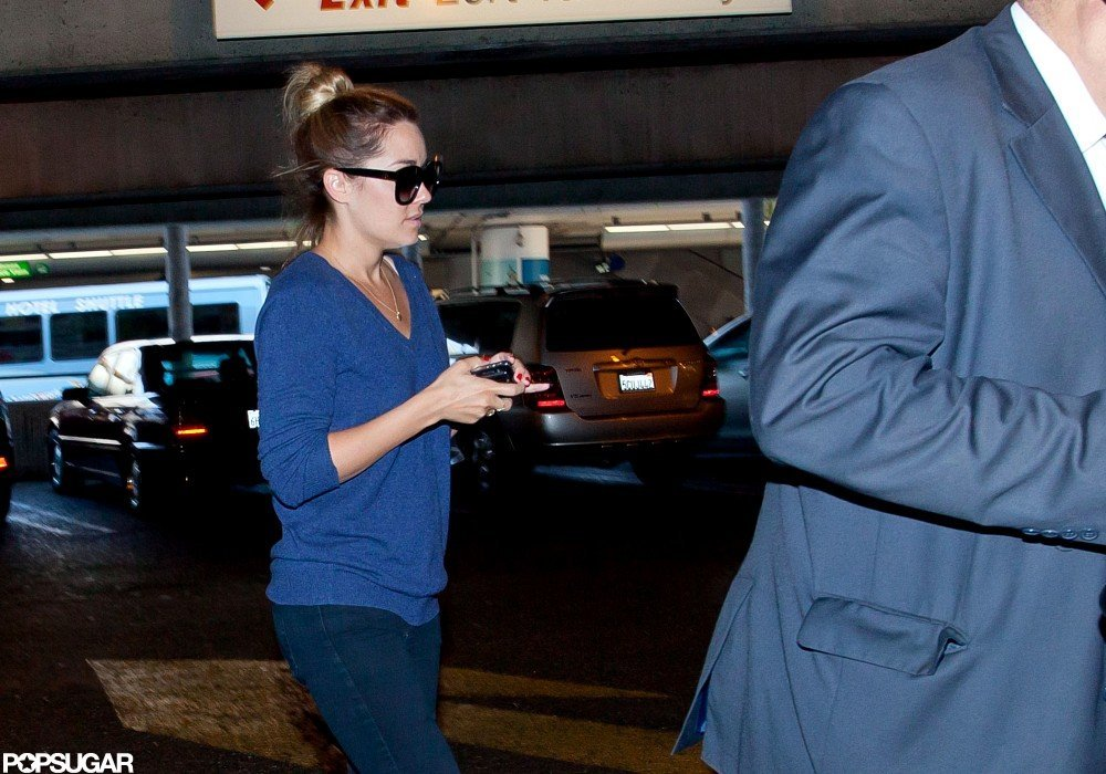 Lauren Conrad arrived at LAX wearing a blue sweater.