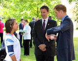 Prince Harry used hand gestures while talking to a school games athlete.