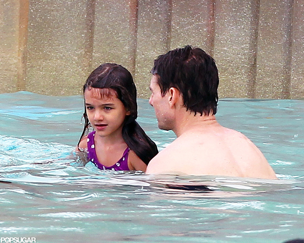 Suri Cruise and Tom Cruise swam around.