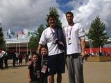 Swimmers Nathan Adrian and Matt Grevers posed for a pic with two tiny fans.  Source: Twitter user nathangadrian