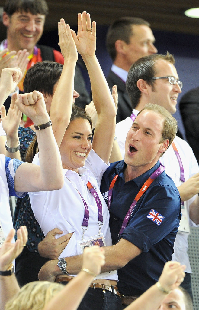 Prince William wrapped his arms around Kate Middleton.
