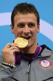 Ryan bit his gold medal without his grill on.
