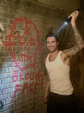 Adam Levine smiled big on the set of American Horror Story. Source: Twitter user MrRPMurphy