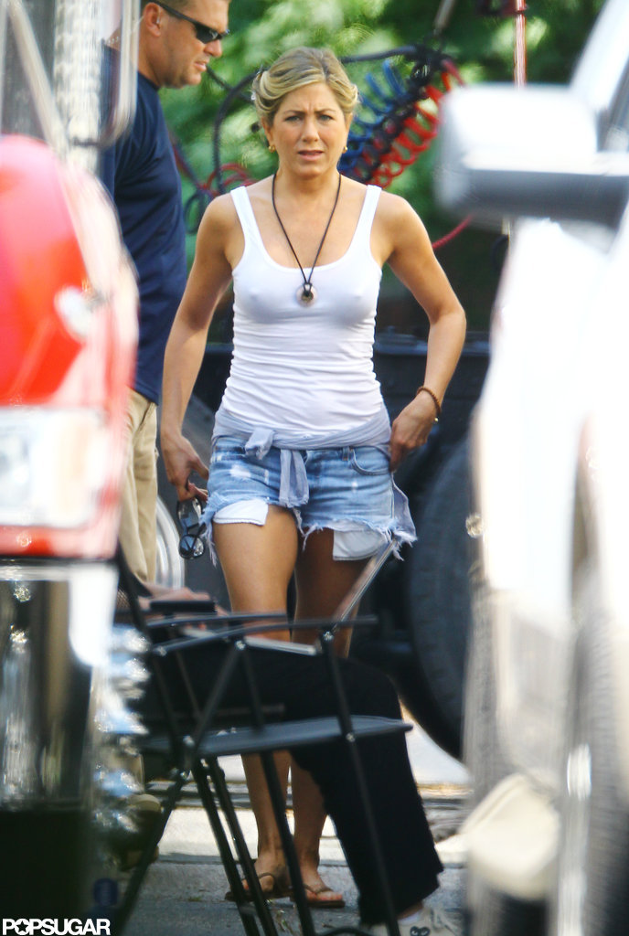 Jennifer Aniston wore a white tank and short denim cut-offs on the set of We're the Millers.