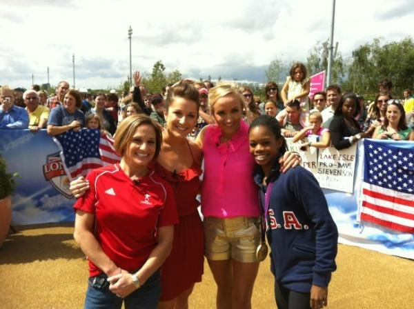 Gabby Douglas posed with four generations of gymnastics champions.  Source: Twitter user marylouretton