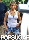 Jennifer Aniston wore a white tank top and cut offs on the set of We're the Millers.