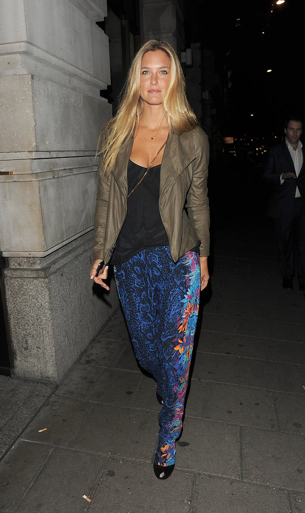 Bar Refaeli balanced statement-print pants with a tougher leather jacket and tank.