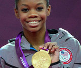 The smile that won the world over! Gabby proudly showed off her gold medal for the individual all-around.