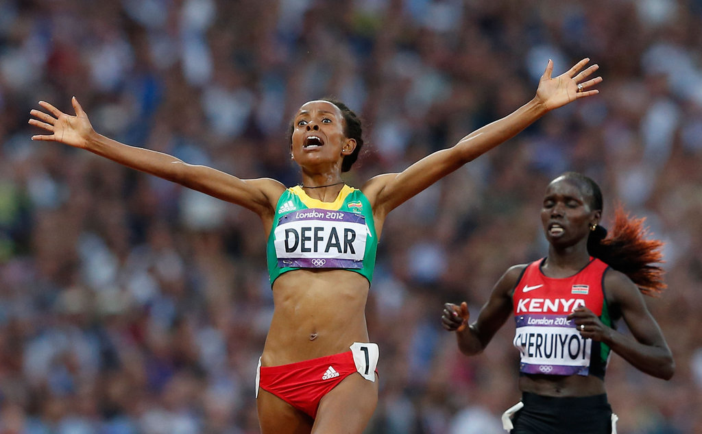 Ethopia's Meseret Defar appeared shocked after crossing the finish line to win gold.