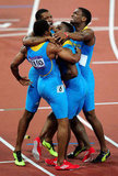 Runners from the Bahamas gave each other a big group hug after winning gold.