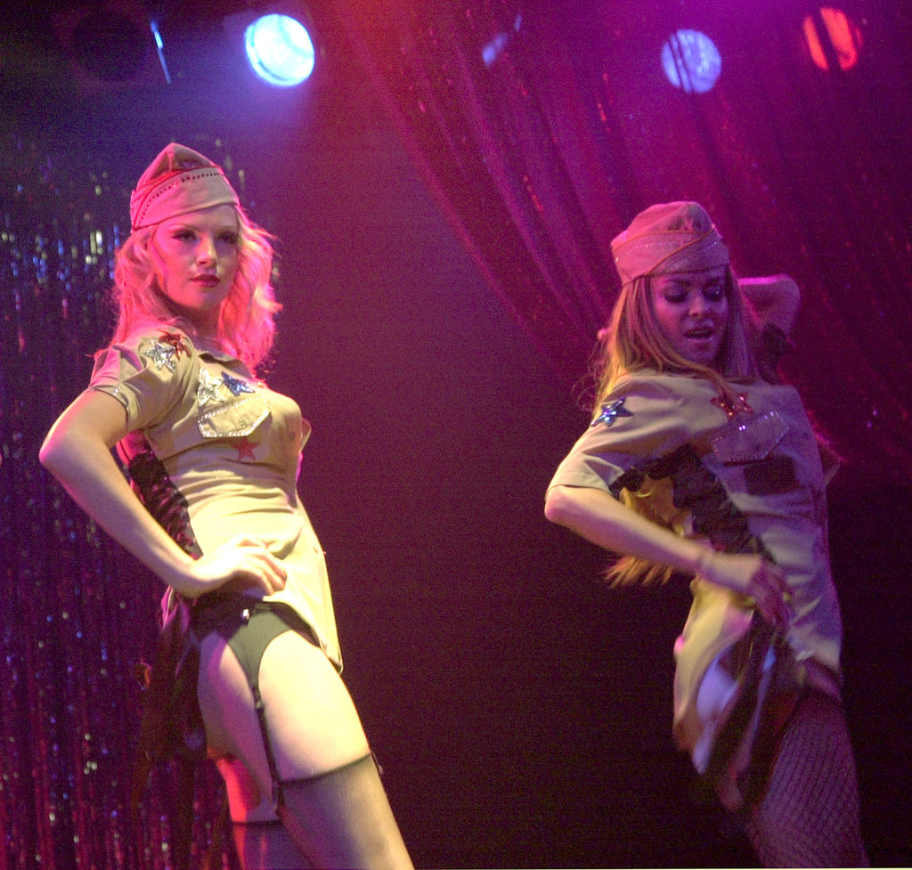 Charlize Theron performed with Carmen Electra and the rest of the Pussycat Dolls in May 2002.