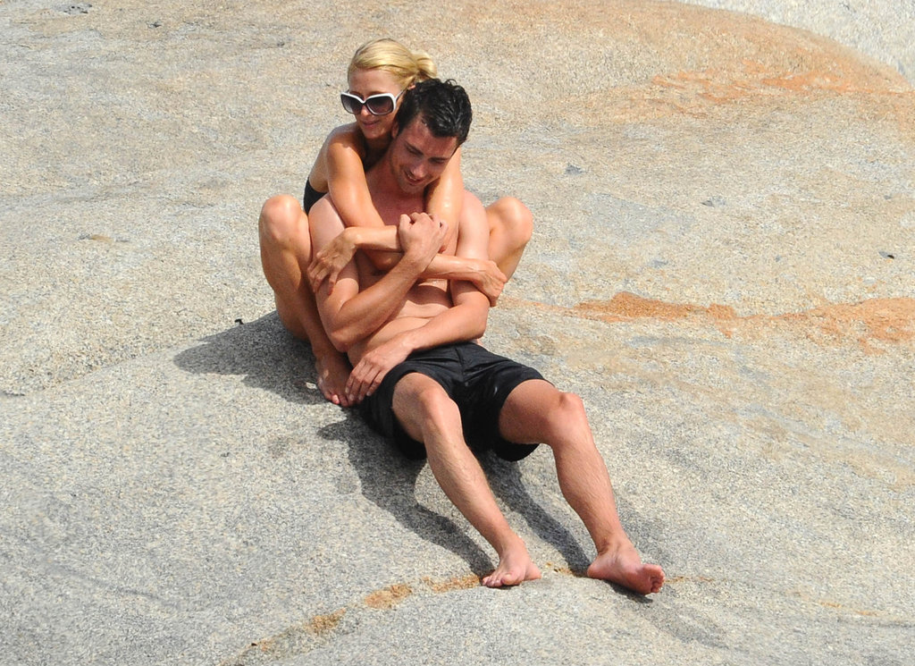 Paris Hilton wrapped her arms around her new man.