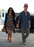 Camila Alves carried her hat in her hand as she walking into LAX with Matthew McConaughey.