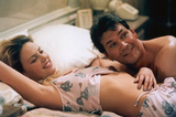 Charlize Theron shared a scene with Patrick Swayze in 2002's Waking Up in Reno. Source: http://miramaxpublicity.com