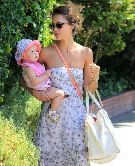 To attend an afternoon pool party, Jessica Alba dressed Haven in a pink romper, a floral sunhat, and butterfly-enhanced sandals.