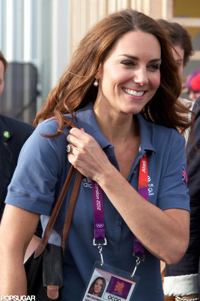 Kate Middleton smiled in a blue shirt.