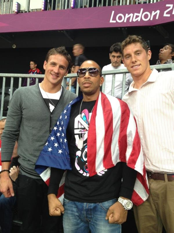 Ryan Lochte and Conor Dwyer got to hang with Ludacris at a basketball game.  Source: Twitter user ryanlochte
