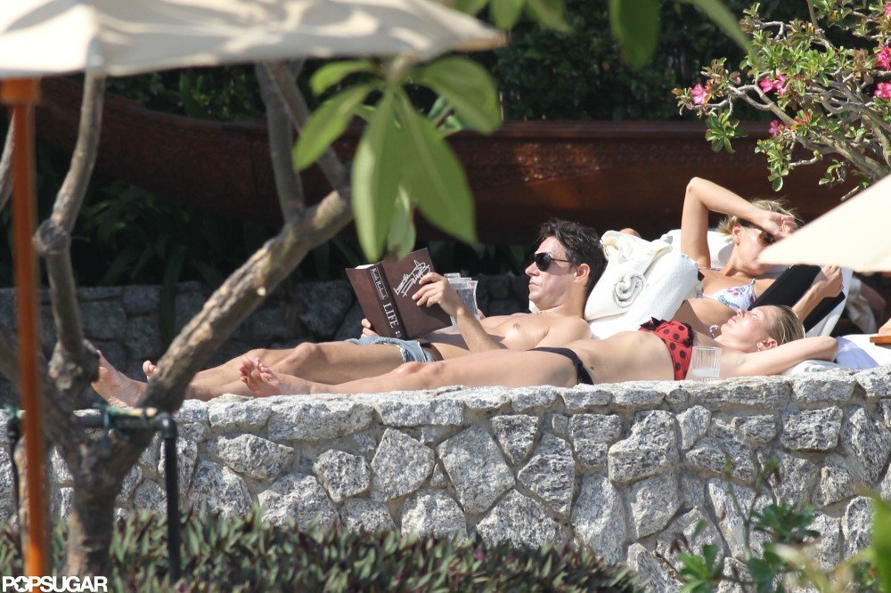 Kate Moss's husband, Jamie Hince, cuddled up with Keith Richards's Life during a getaway to Thailand in January 2011. Meanwhile, Kate read Carl Reiner's All Kinds of Love.