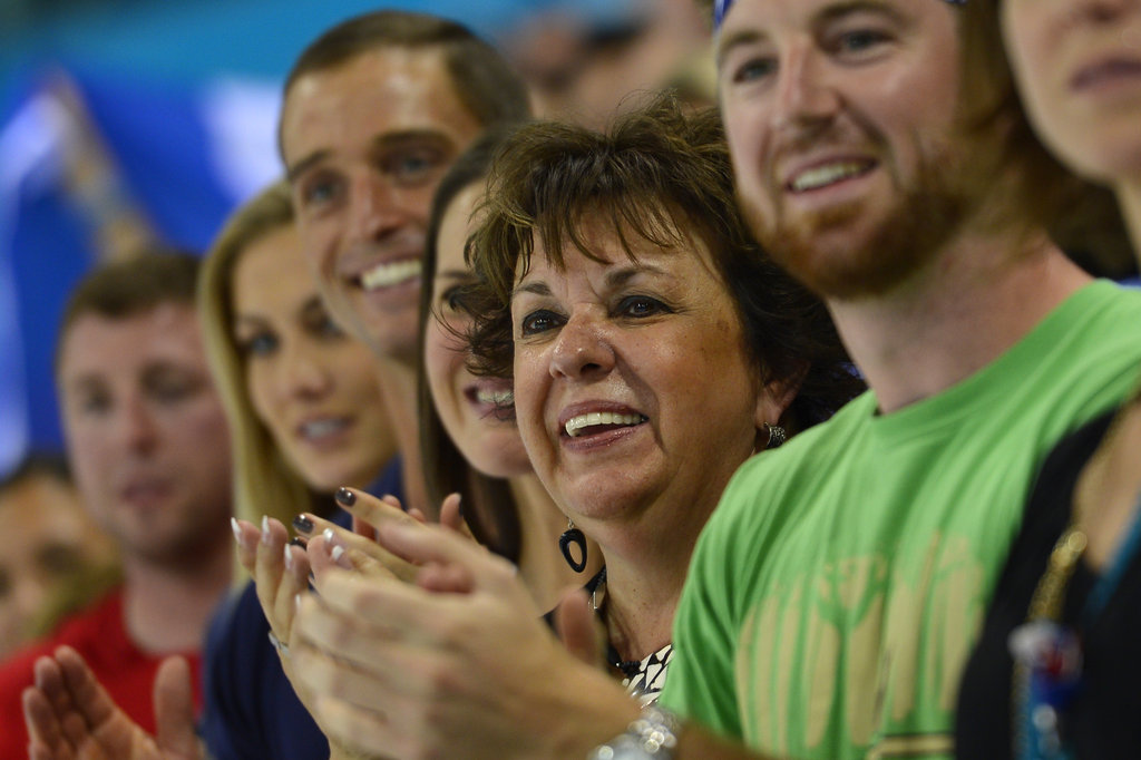 Megan Rossee applauded alongside Debbie Phelps during one of Michael Phelps's medal ceremonies at the 2012 London Olympics in July.