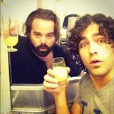 Adrian Grenier enjoyed a cocktail with a friend while en route to Europe. Source: Instagram user adriangrenier