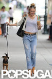 Miley Cyrus walked with her dog, Happy, in Philadelphia.