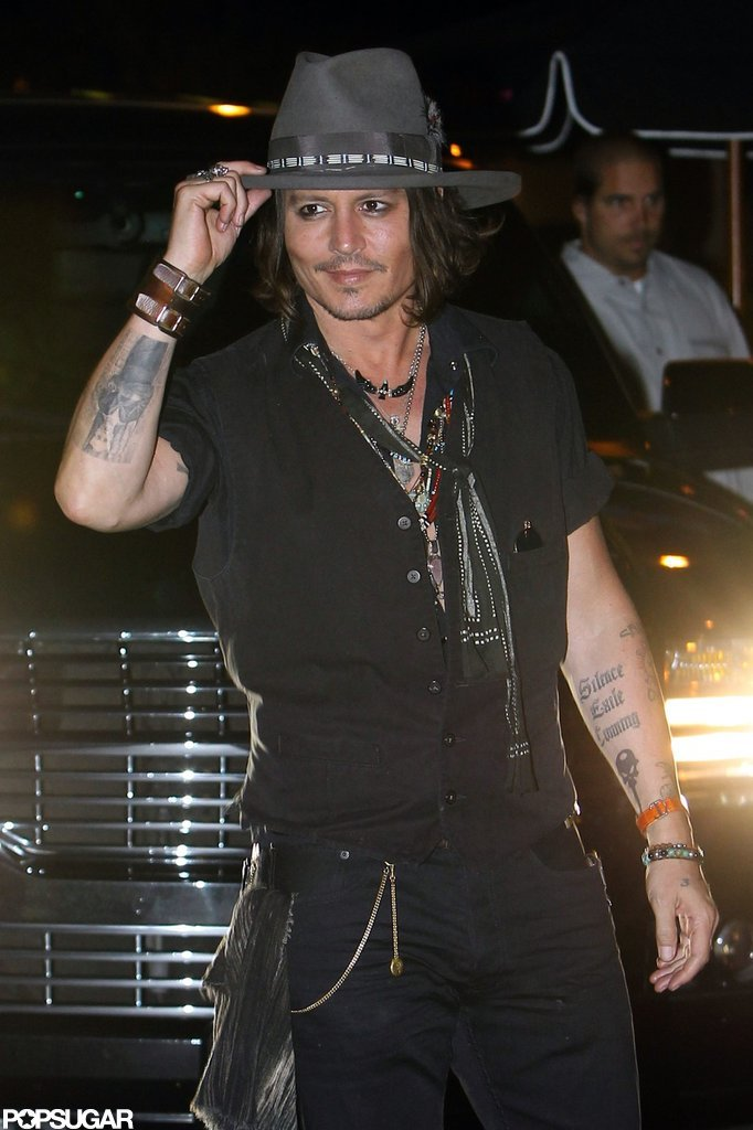 Johnny Depp tipped his hat on the way into Aerosmith's afterparty in LA.