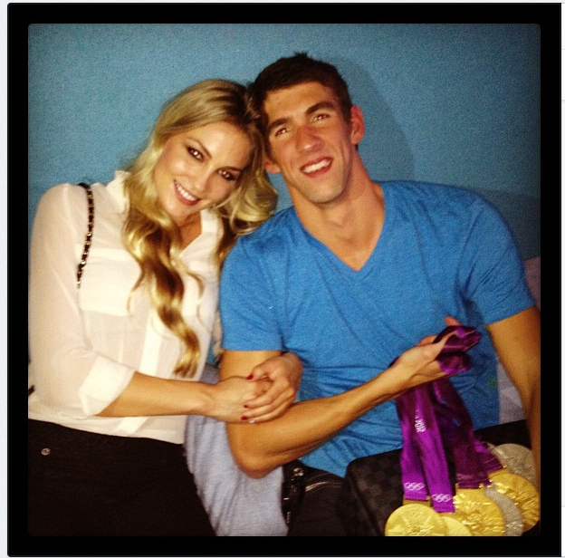 "In August, Megan Rossee Instagrammed a photo of her with Michael Phelps and his gold medals, saying, ""Yay Michael."" Source: Twitter user MeganRossee"