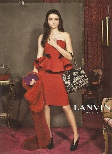 A stunning strapless red peplum dress steals the scene in the Lanvin Fall 2012 ad.