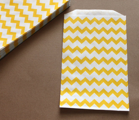 Instead of traditional red-and-white-striped popcorn bags, choose an option that celebrates your color scheme. We're crazy about these cheery-hued Chevron Favor Bags ($6 for 20)!