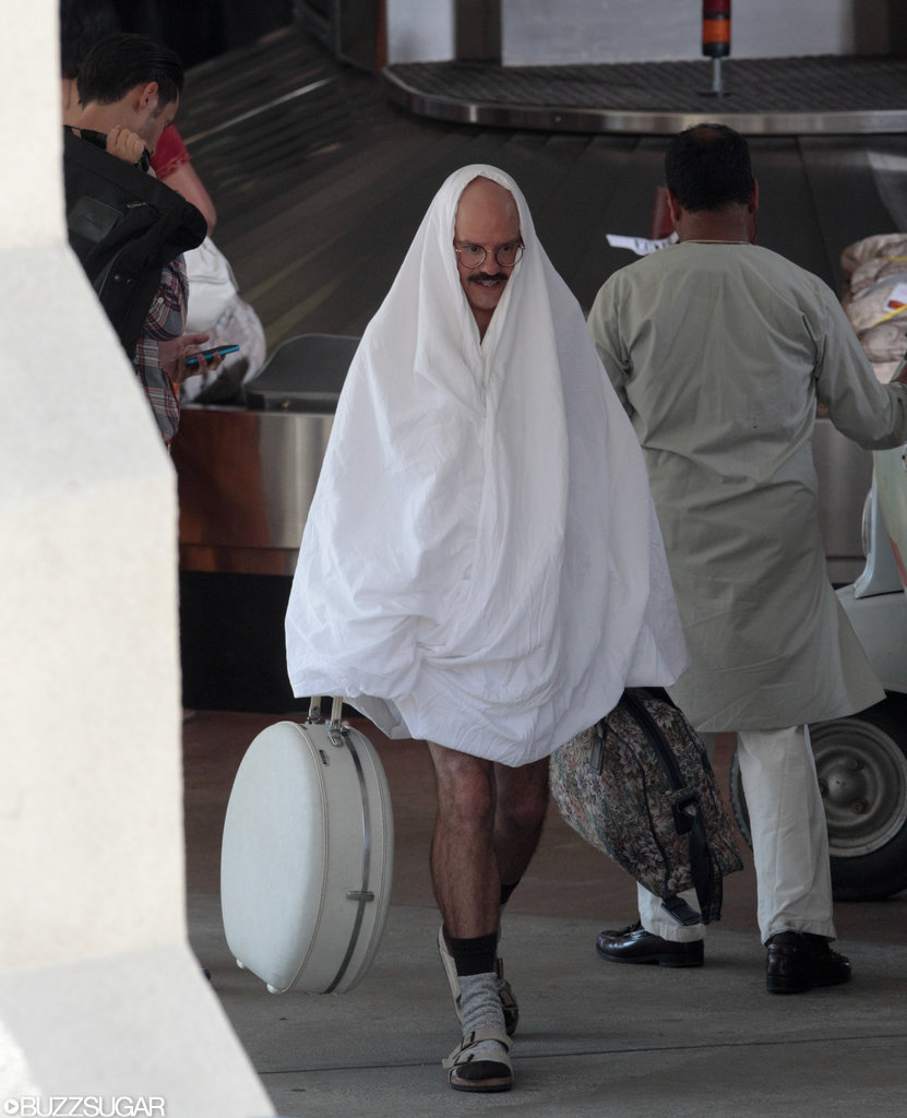 We assume David Cross was in character as Tobias Funke as he walked around cloaked in a sheet.