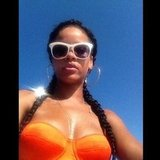 Rihanna soaked up the sun in a bright bikini and shades.  Source: Instagram user badgalriri