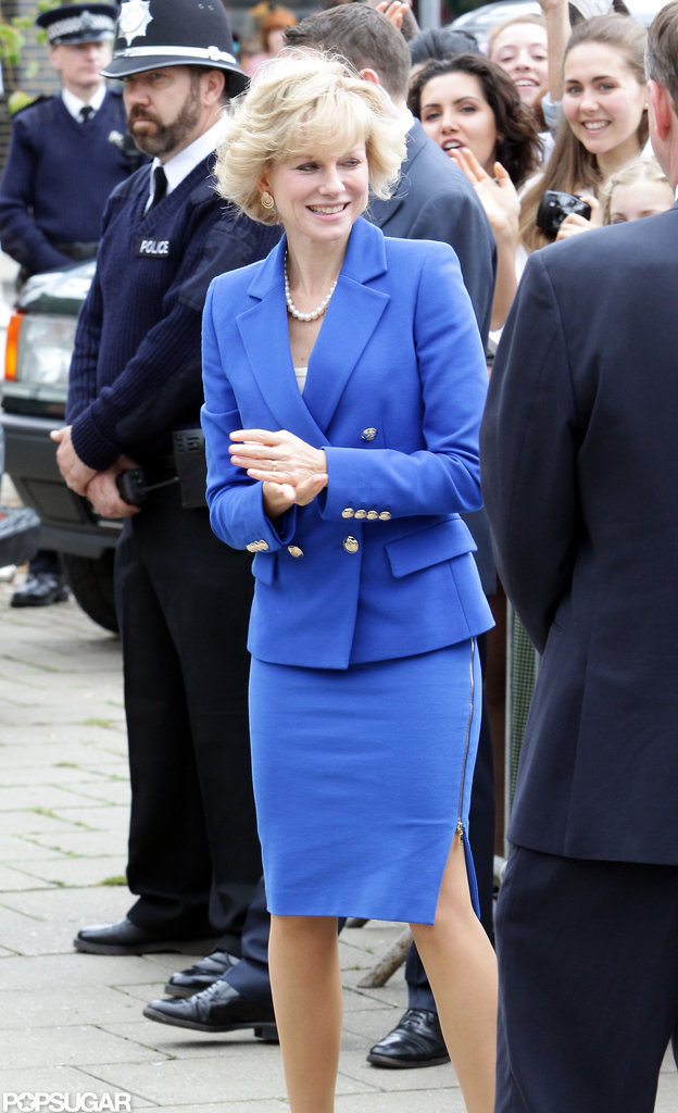 Naomi Watts donned a blue suit jacket with a skirt while filming on set.