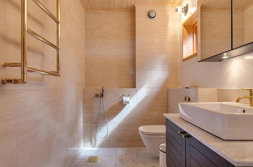 Bathroom walls and floors are covered in Carrera marble.