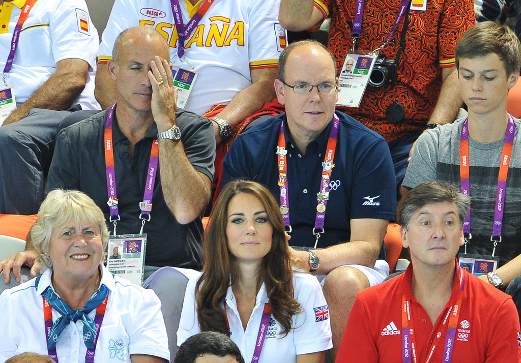 Kate Middleton, GB ambassador Robin Cousins, and Prince Albert II attended the women's teams synchronized swimming event at the Olympics Aquatics Centre in London.