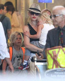 Gwen Stefani Heads Home with Her Tired Travel Companions