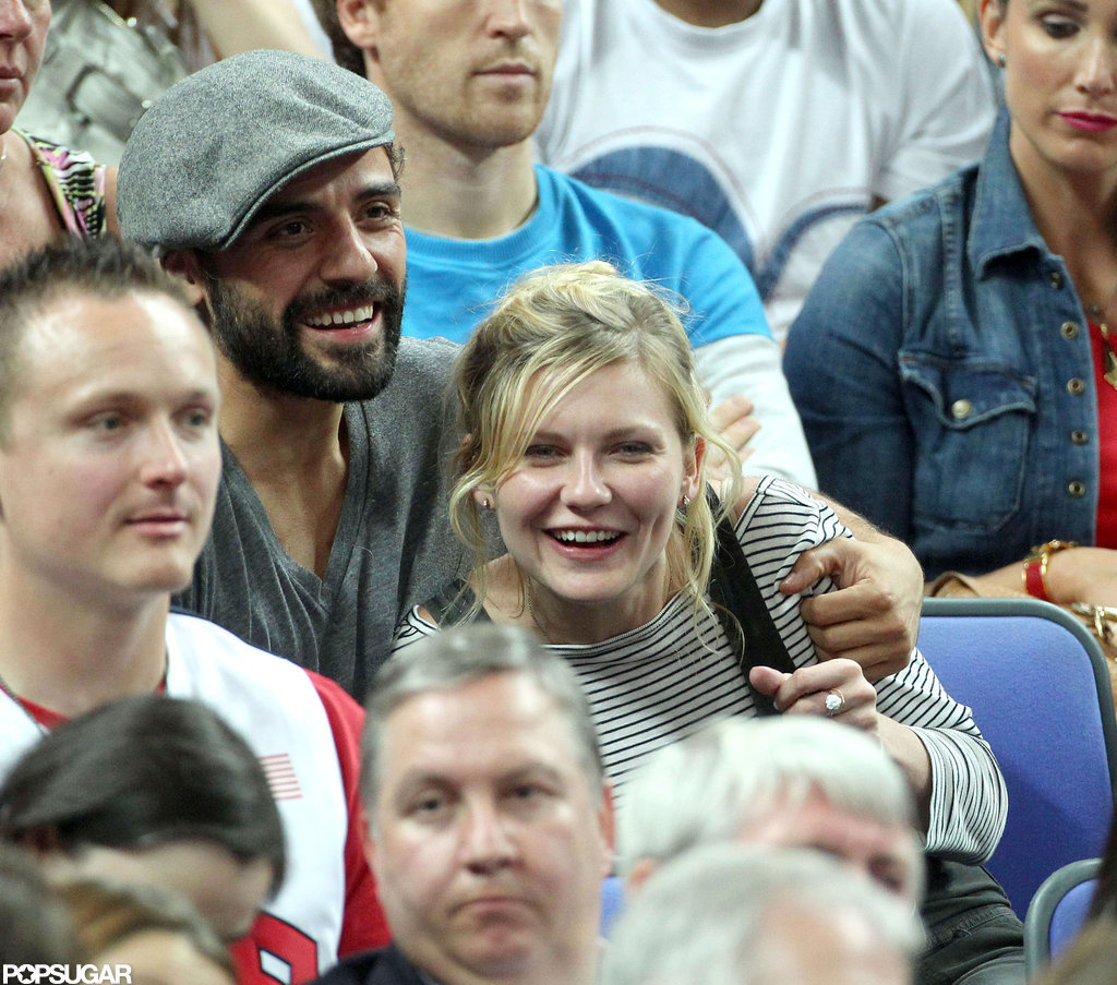 Kirsten Dunst and Oscar Issac both smiled while watching the Olympic basketball game.